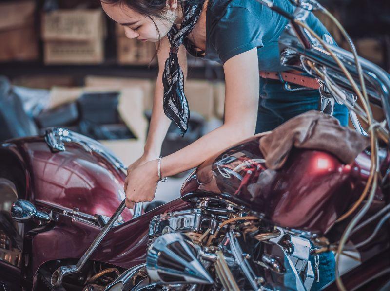 woman working on bike