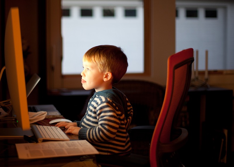 boy reading on computer