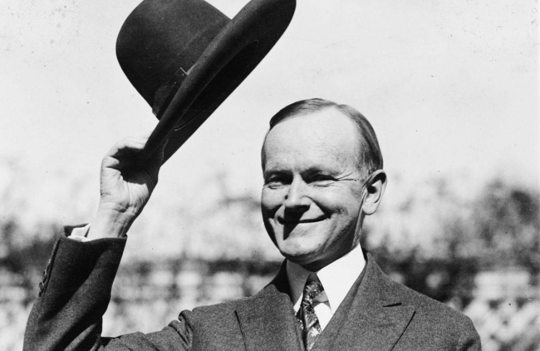 man tipping hat