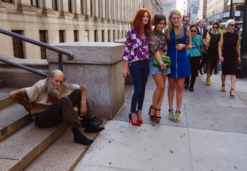 privileged women and homeless man