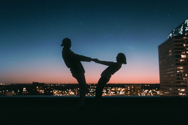 man and woman balancing